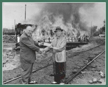 James Towley & Fred Ossanna in front of burning streetcar